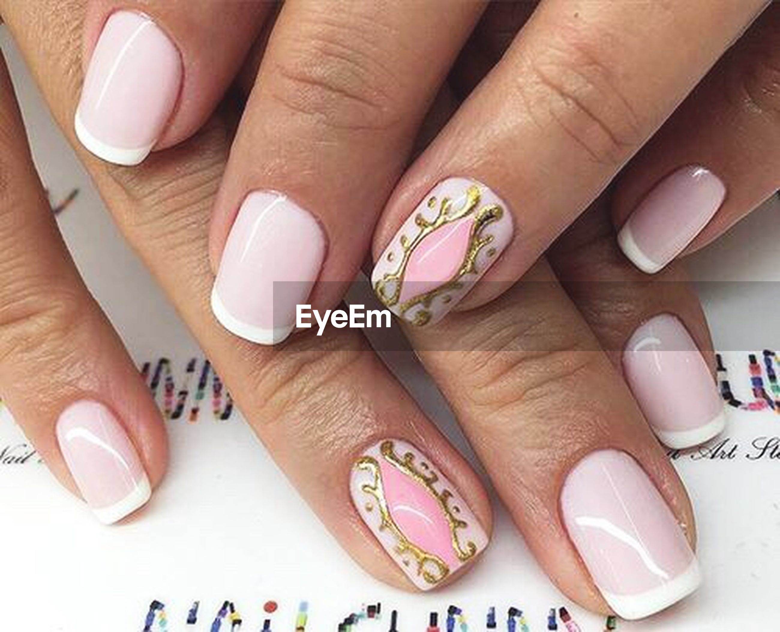 person, part of, indoors, human finger, cropped, holding, high angle view, close-up, nail polish, variation, text, unrecognizable person, personal perspective, jewelry, showing, ring