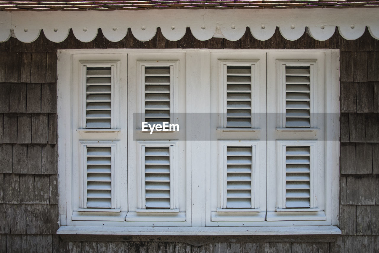 built structure, window, architecture, building exterior, no people, day, building, house, wood - material, pattern, outdoors, roof, wall - building feature, low angle view, brown, shape, full frame, design, side by side, residential district, window frame