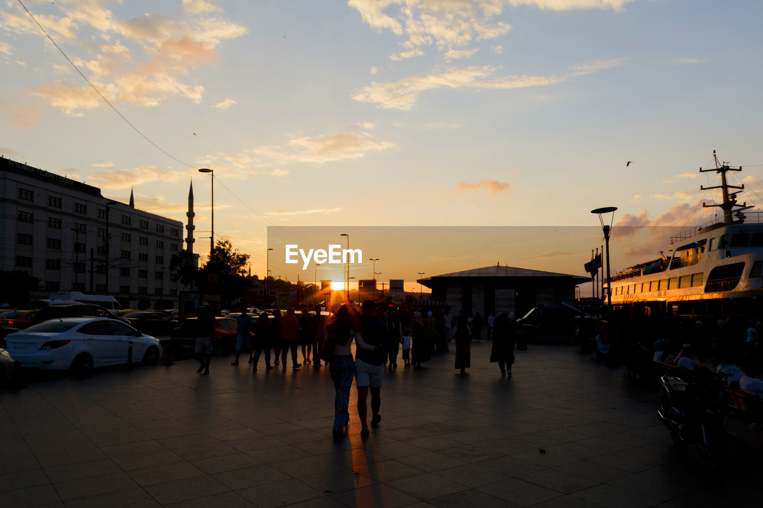 People on city street at sunset