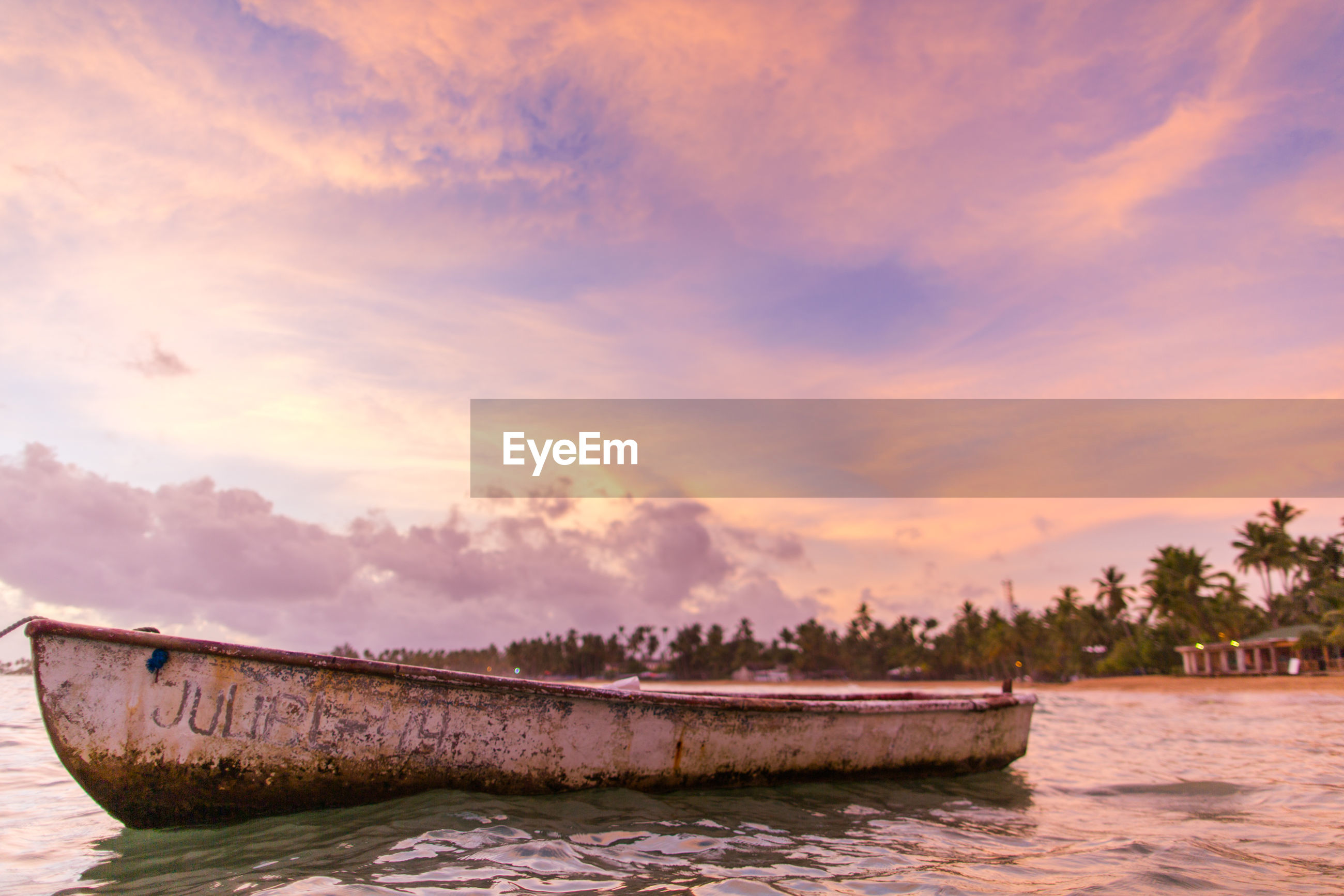 water, nautical vessel, transportation, tranquil scene, boat, waterfront, tranquility, cloud, scenics, sky, calm, nature, day, cloud - sky, beauty in nature, cloudy, sea, outdoors, cloudscape, dramatic sky, ocean, surface level, tourism