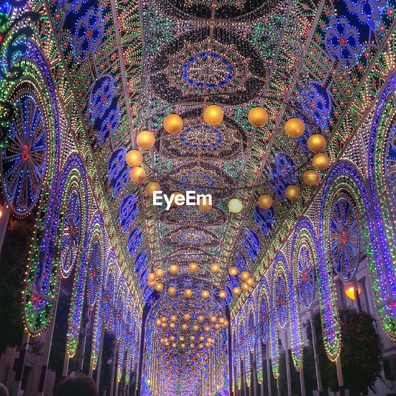 decoration, illuminated, pattern, lighting equipment, multi colored, no people, indoors, low angle view, built structure, ceiling, architecture, art and craft, design, ornate, creativity, celebration, hanging, religion, building, purple, luxury, floral pattern