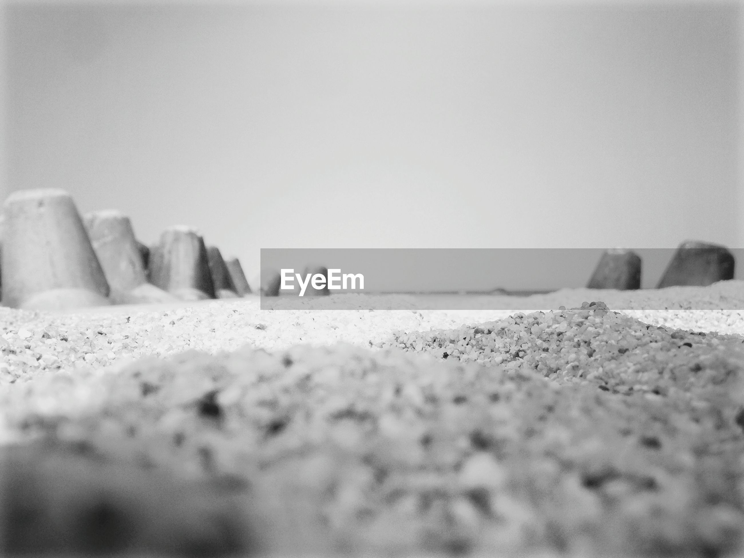 beach, sand, selective focus, day, rock - object, outdoors, nature, no people, sea, clear sky, close-up, sky, salt - mineral, pebble beach
