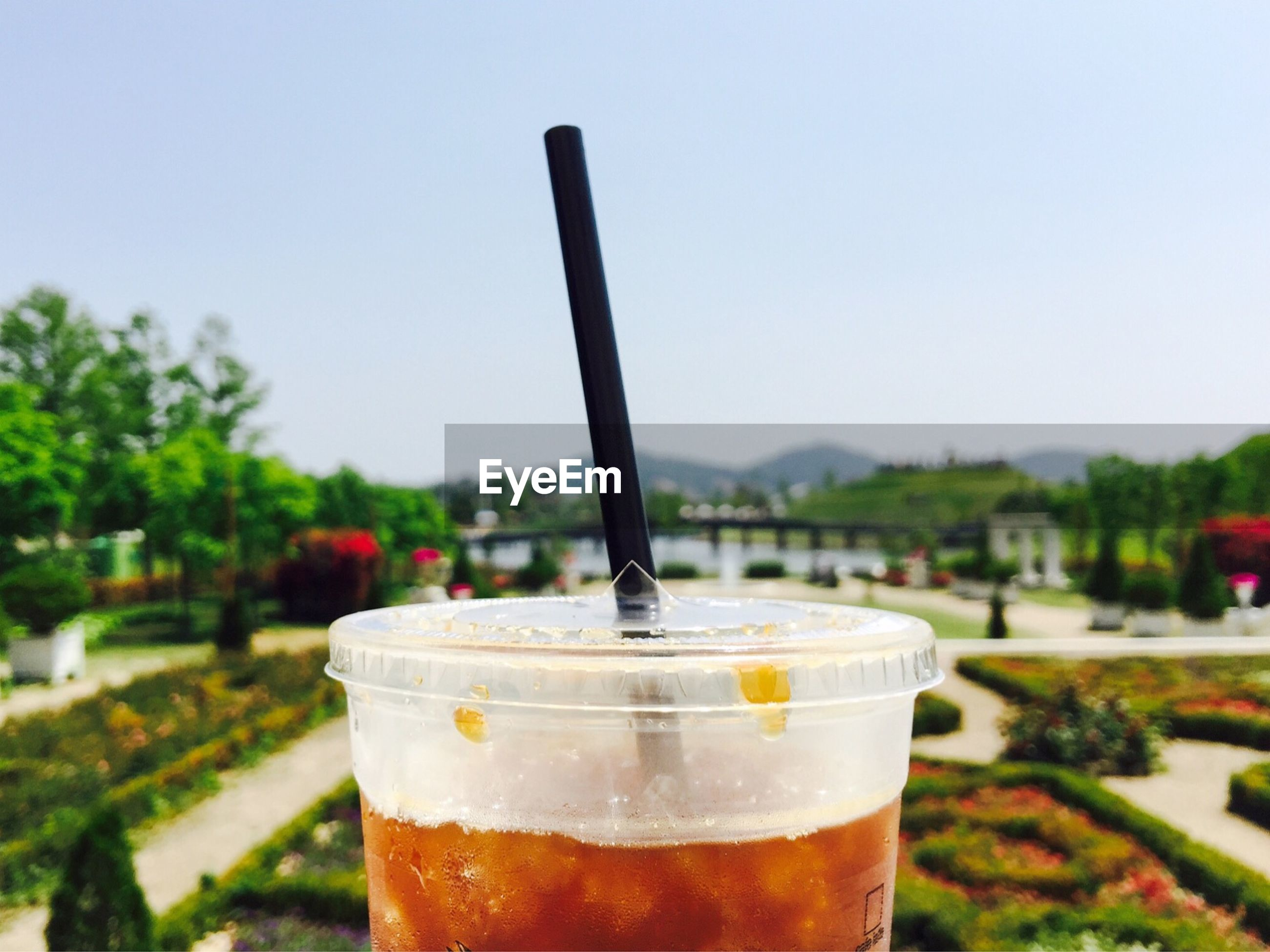 food and drink, focus on foreground, drink, refreshment, close-up, freshness, drinking glass, still life, selective focus, clear sky, drinking straw, sky, day, outdoors, table, alcohol, no people, cold temperature, frothy drink, glass - material