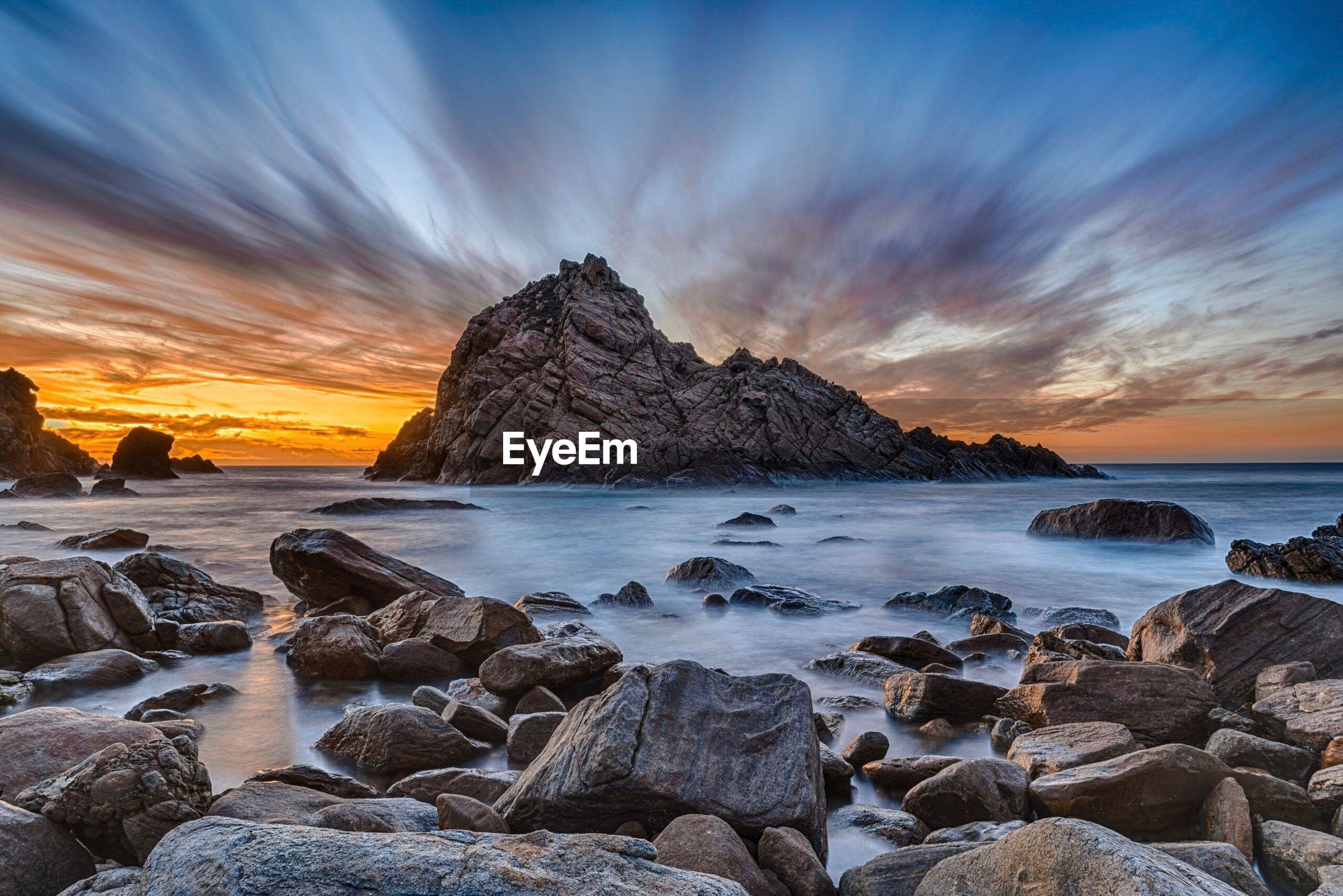 Scenic view of sugarloaf rock against cloudy sky