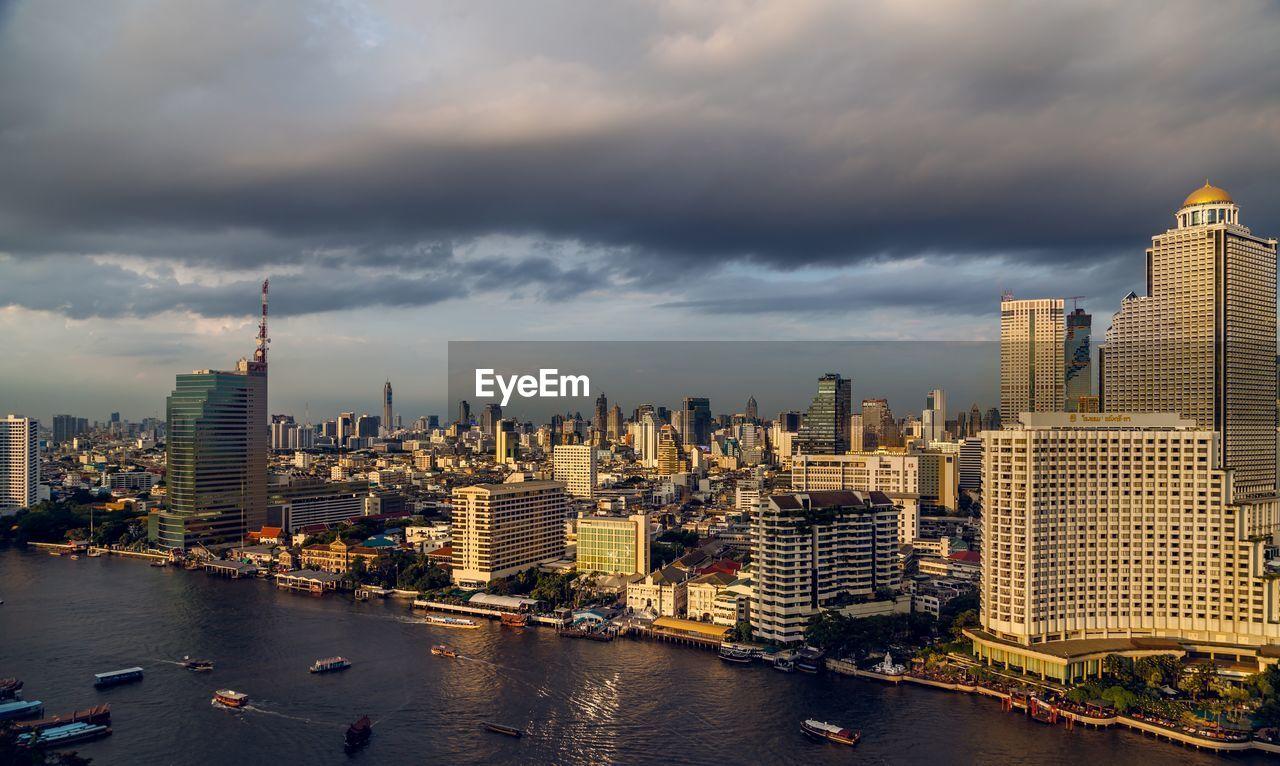 PANORAMIC VIEW OF MODERN BUILDINGS AGAINST SKY