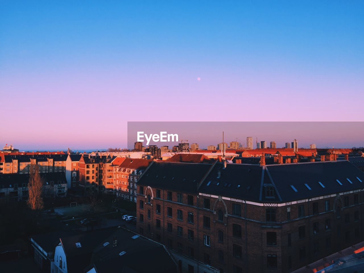 High angle view of buildings against clear sky during sunset