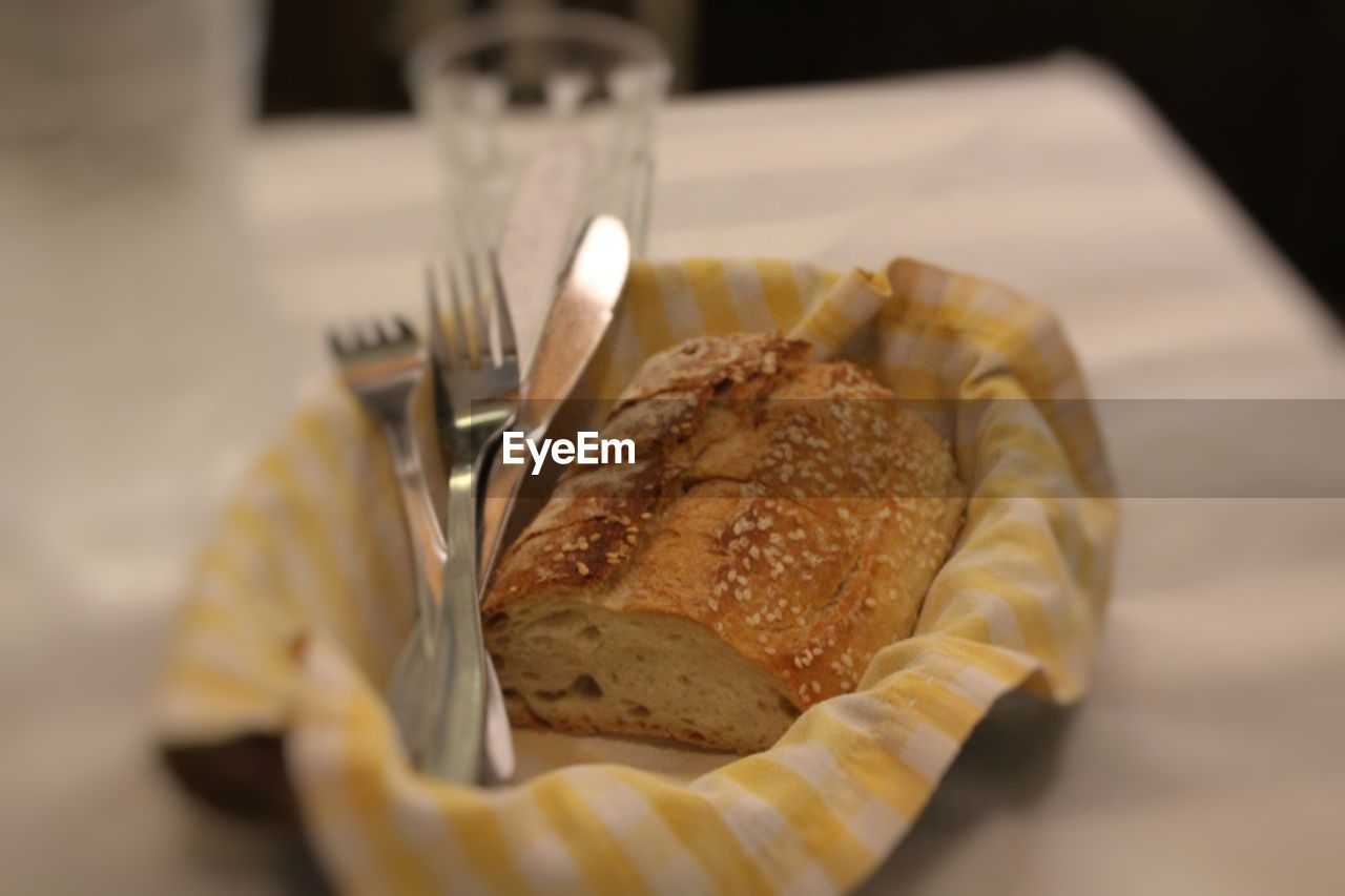 food and drink, food, bread, indoors, freshness, still life, table, ready-to-eat, eating utensil, close-up, baked, fork, selective focus, no people, kitchen utensil, high angle view, plate, focus on foreground, unhealthy eating, serving size, french food, table knife, breakfast, snack, temptation