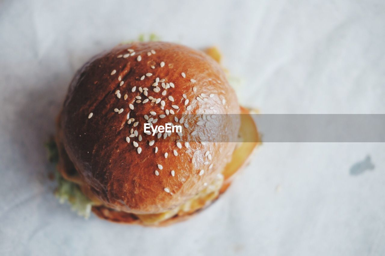 High angle view of burger on paper