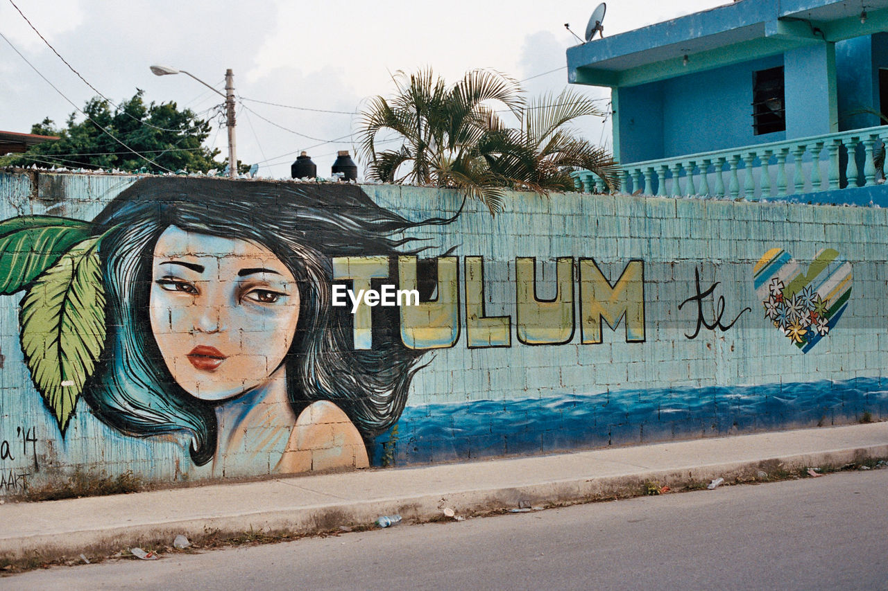 graffiti, art and craft, architecture, creativity, built structure, building exterior, outdoors, day, water, no people, tree, sky