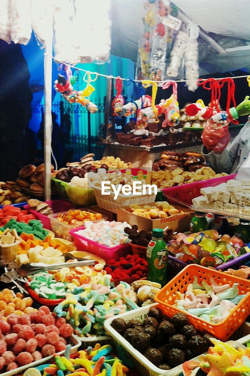 food and drink, variation, food, choice, freshness, multi colored, for sale, sweet food, retail, indulgence, abundance, no people, indoors, large group of objects, dessert, arrangement, temptation, market, fruit, healthy eating, ready-to-eat, day, close-up