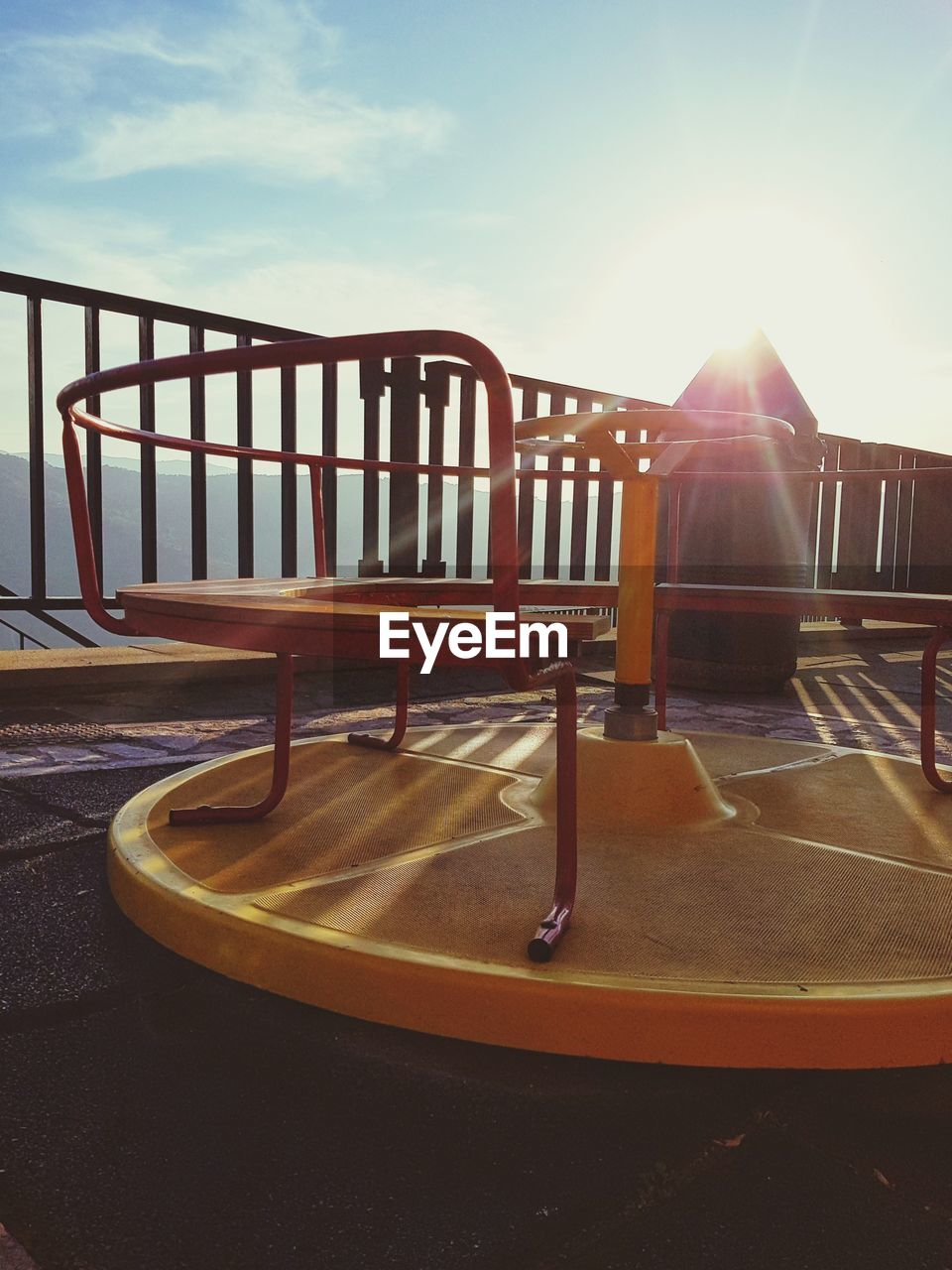 sky, absence, chair, nature, seat, no people, empty, railing, lens flare, day, sunlight, sunbeam, sun, outdoors, sunset, table, wood - material, architecture, water, swimming pool