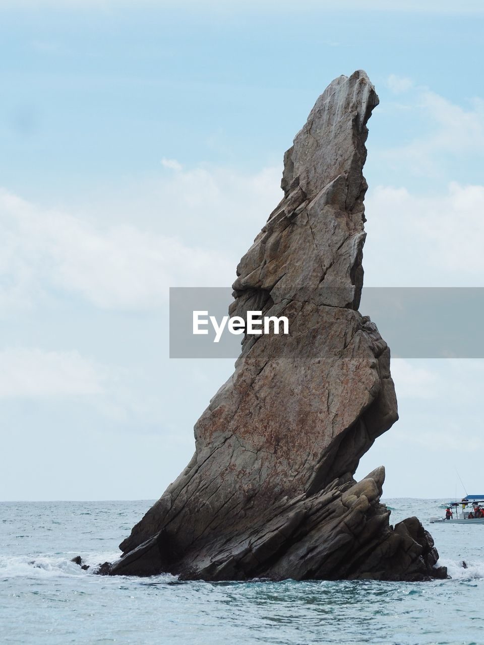 SCENIC VIEW OF ROCK FORMATION ON SEA AGAINST SKY