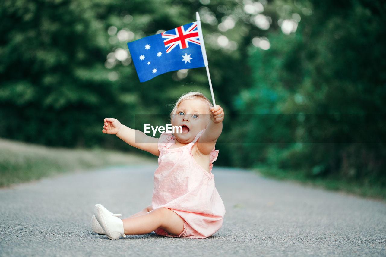 Cute girl looking away flag