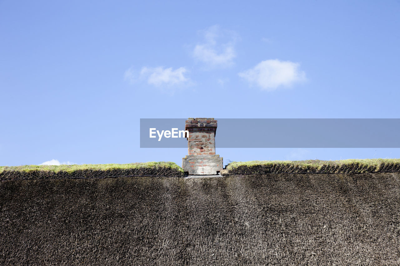 sky, field, land, architecture, built structure, nature, day, no people, blue, landscape, building exterior, old, environment, cloud - sky, outdoors, plant, scenics - nature, grass, building, protection