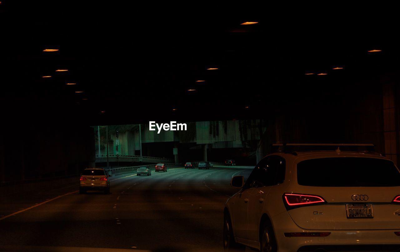 car, illuminated, night, transportation, land vehicle, no people, outdoors, city, parking garage
