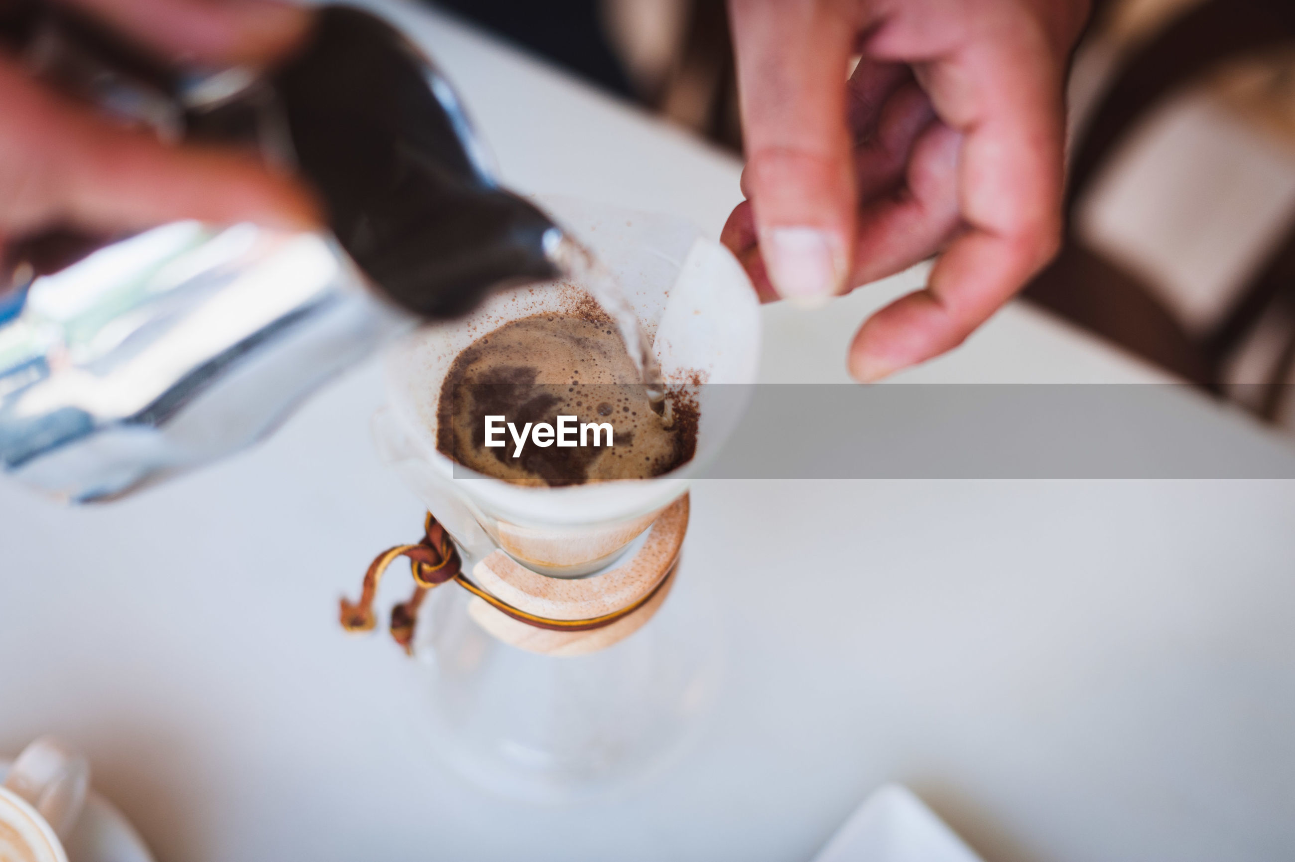 Cropped image of barista making coffee at cafe