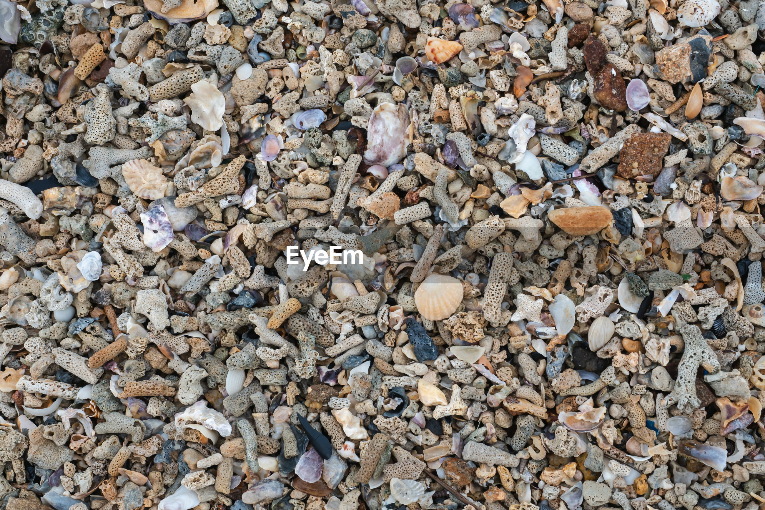 FULL FRAME SHOT OF STONES ON BEACH