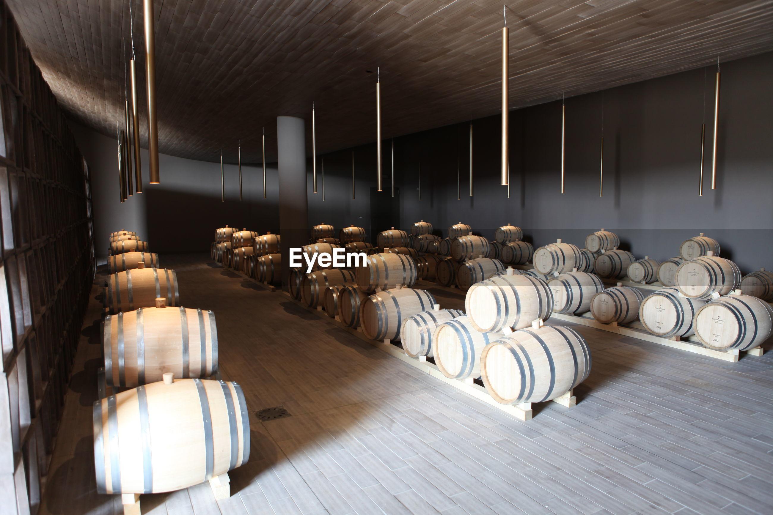 Barrels arranged in wine cellar