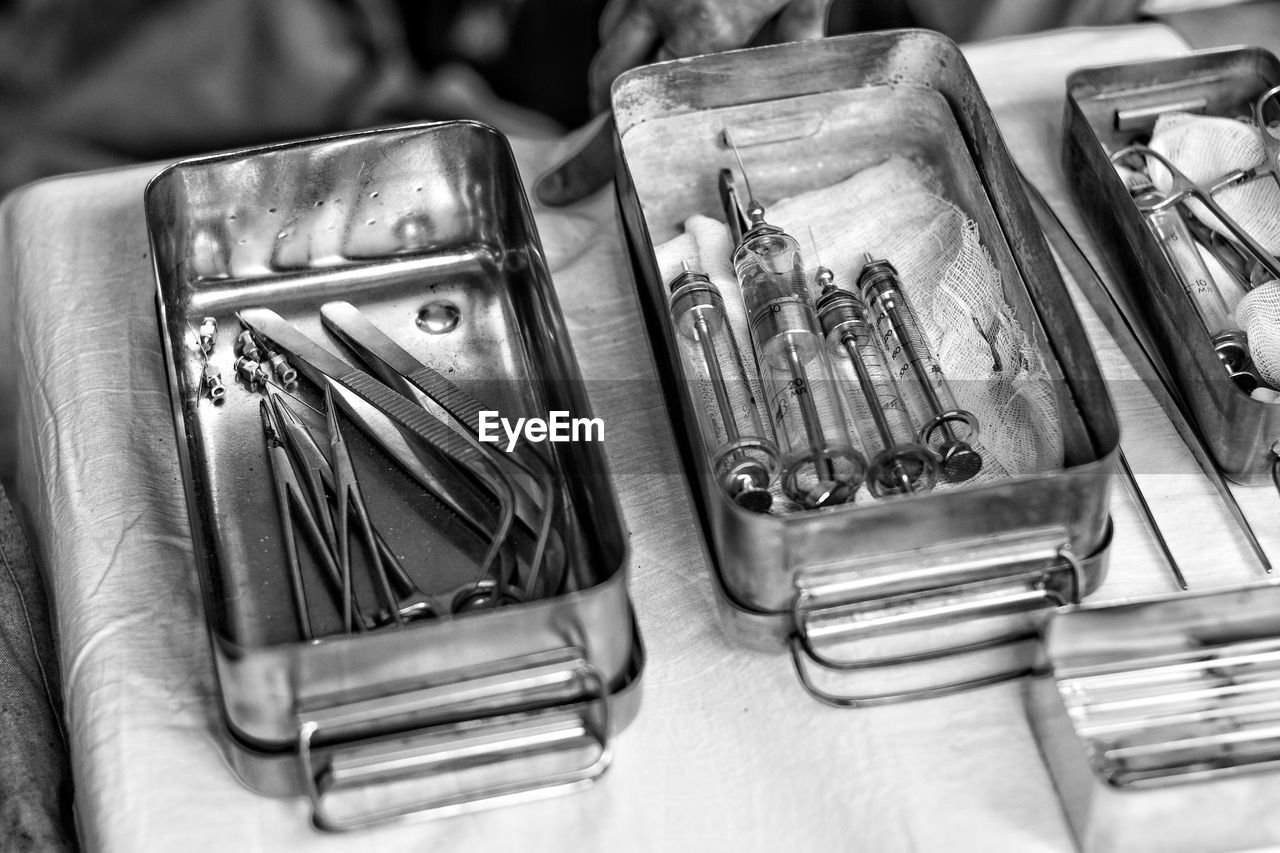 Close-up of syringes on table