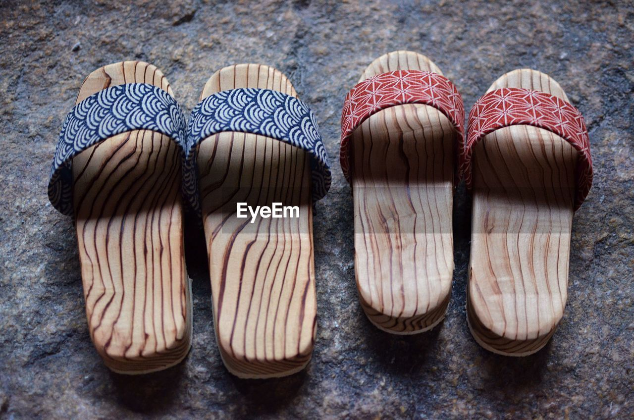 High angle view of sandals on road