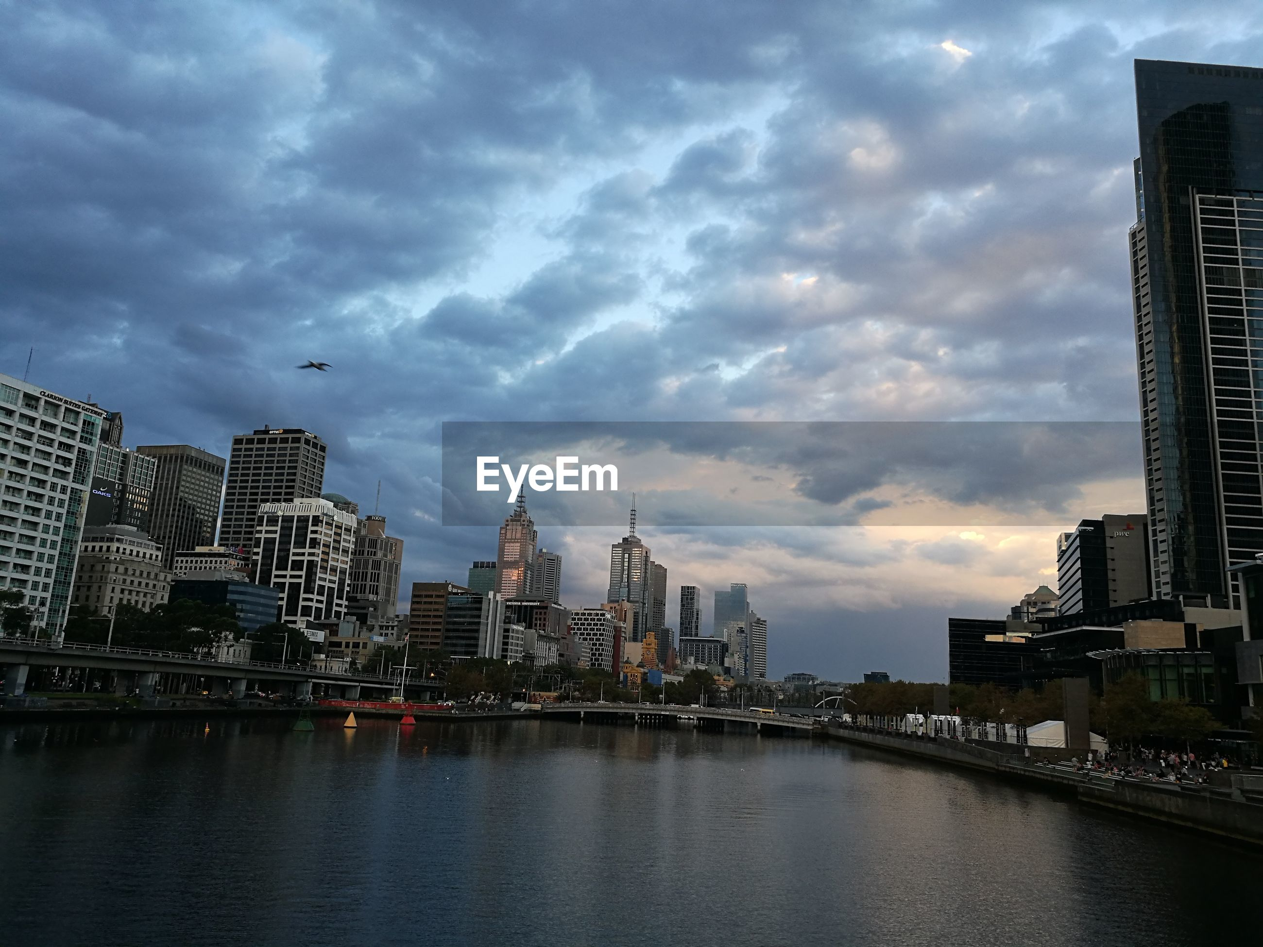 VIEW OF SKYSCRAPERS AT WATERFRONT