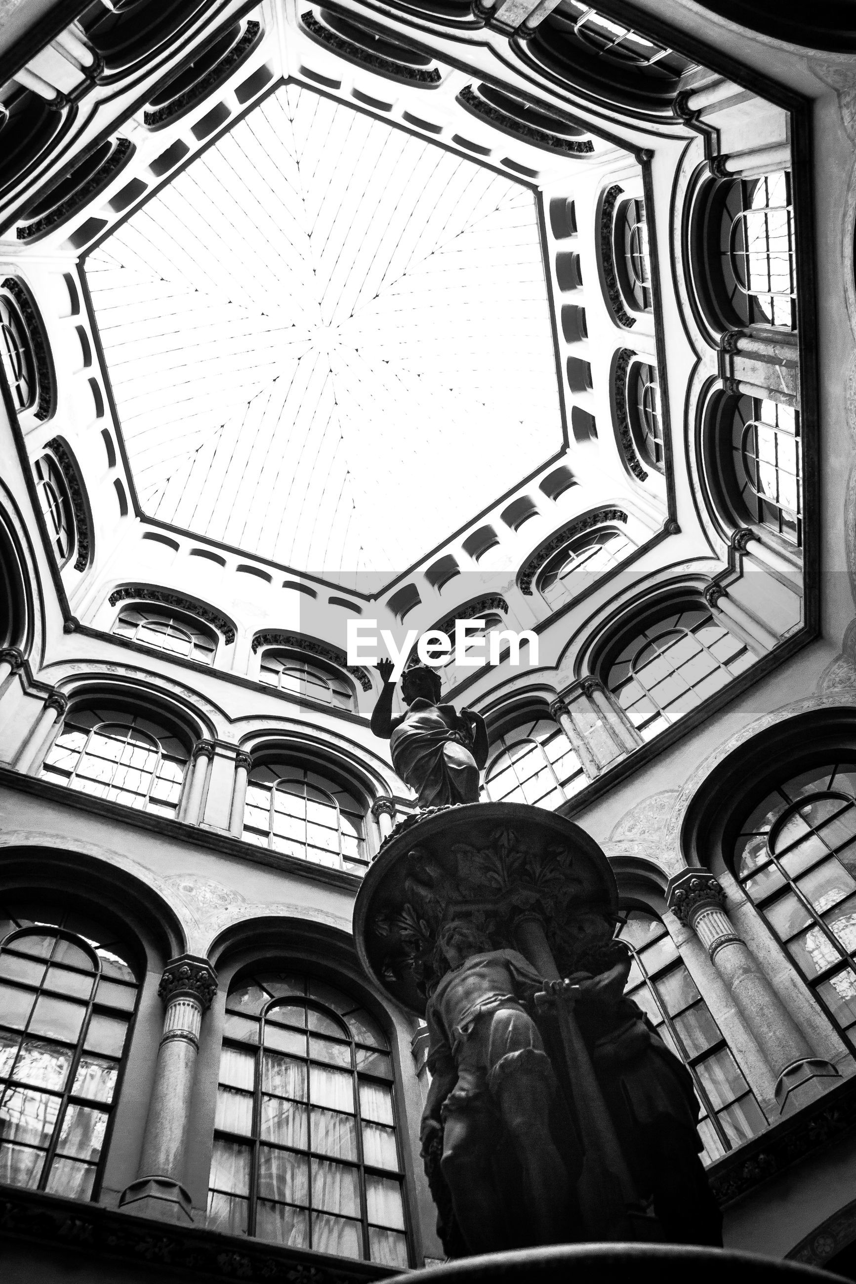 Low angle view of sculpture in cupola