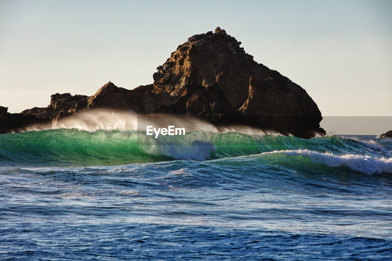 sea, sky, motion, water, wave, beauty in nature, waterfront, scenics - nature, nature, rock, splashing, rock - object, no people, solid, rock formation, power in nature, sport, land, outdoors, flowing water, breaking