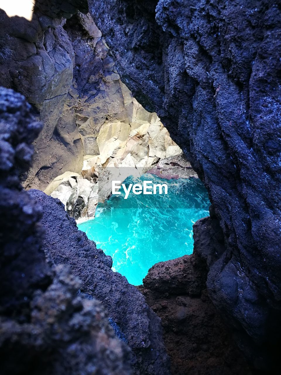 rock - object, rock formation, geology, water, beauty in nature, nature, physical geography, blue, cave, outdoors, no people, scenics, day