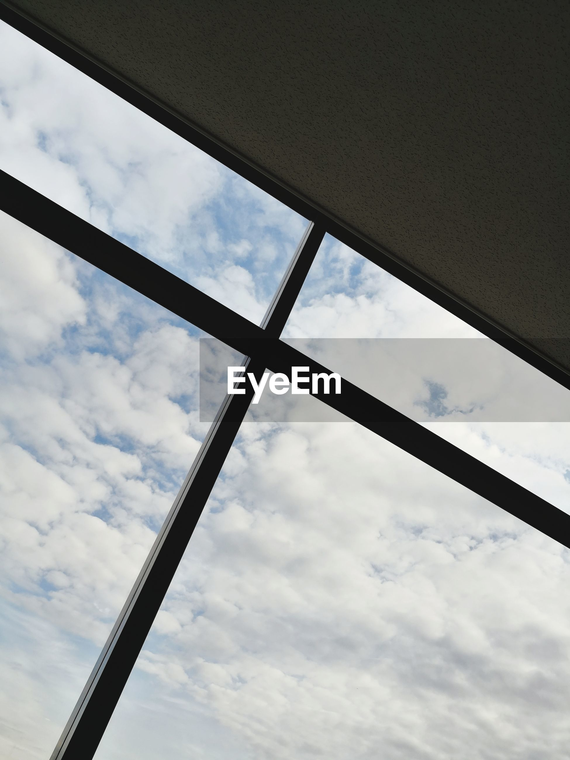 LOW ANGLE VIEW OF SKY THROUGH WINDOW