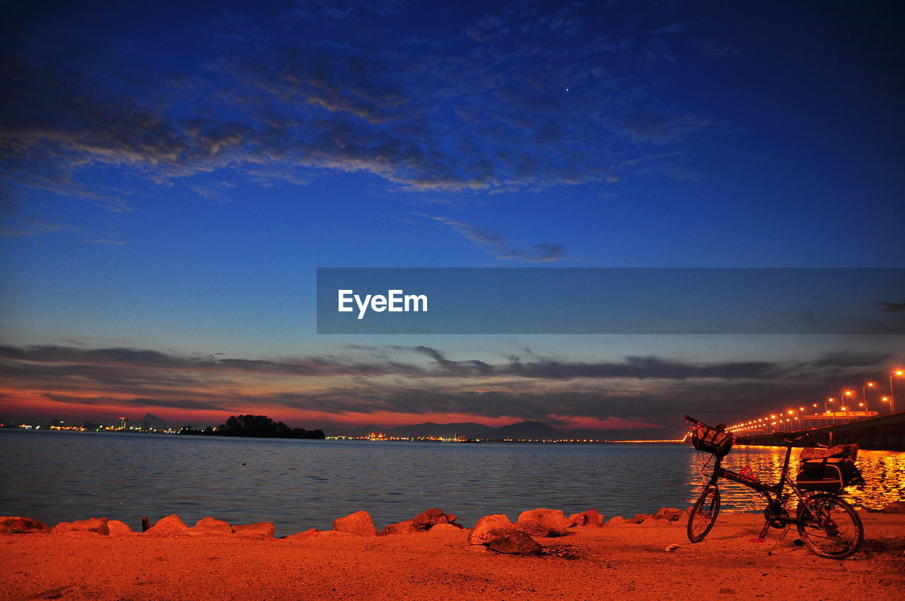 sky, sunset, beauty in nature, beach, sea, nature, water, scenics, cloud - sky, outdoors, blue, no people, night