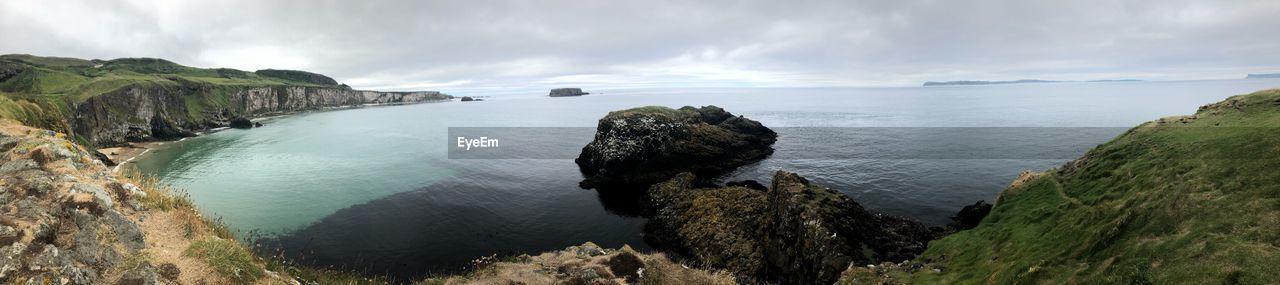 Panoramic Shot Of Rocks On Sea Against Sky