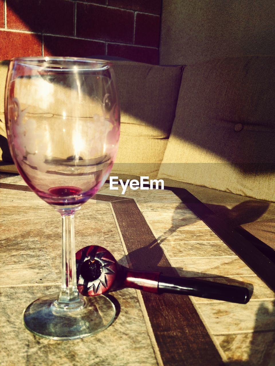 wineglass, table, wine, indoors, food and drink, refreshment, alcohol, drinking glass, drink, red wine, no people, close-up, freshness, day