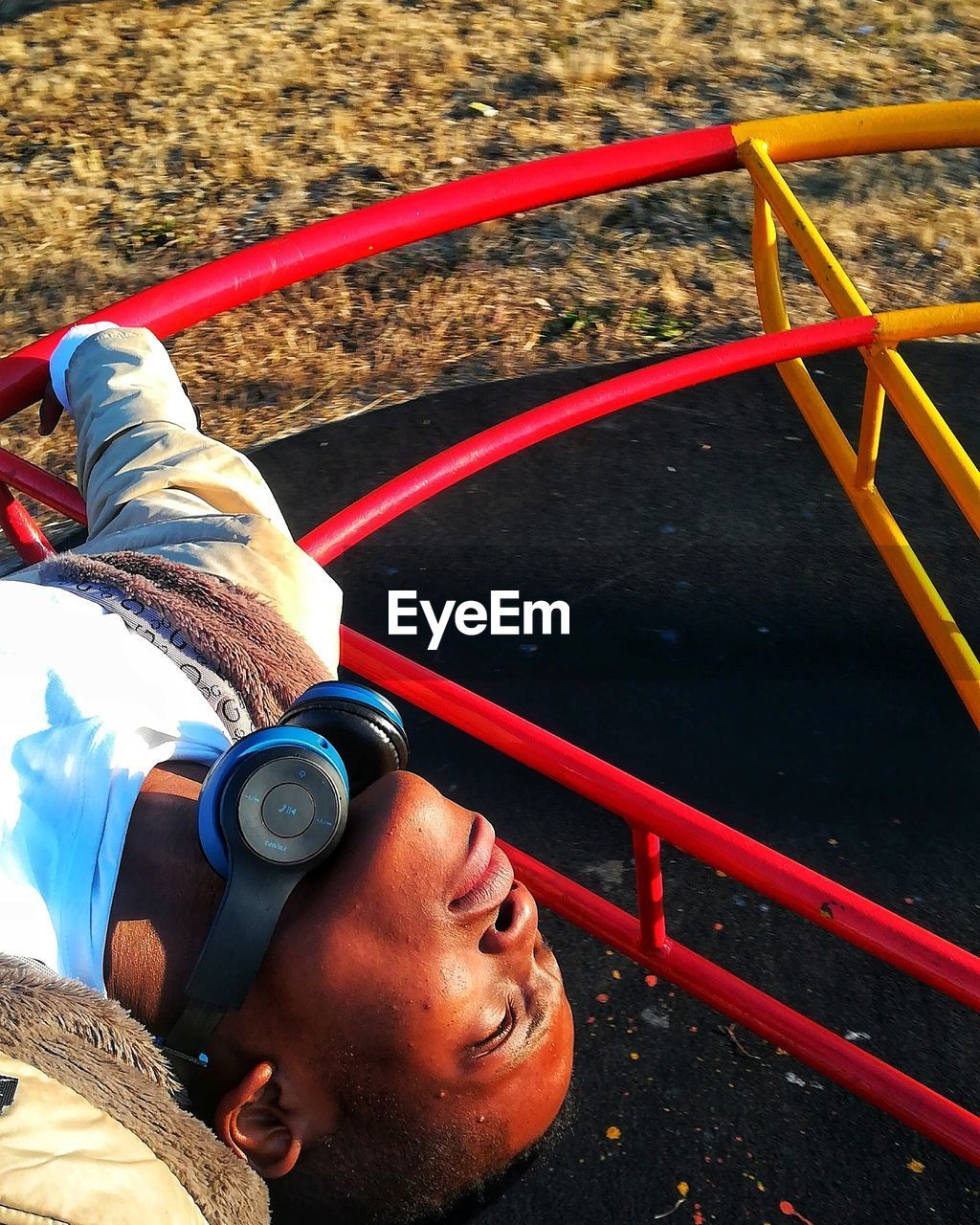 High Angle View Of Young Man In Playground