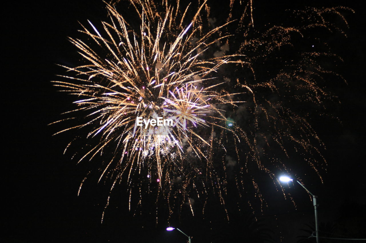 night, firework, illuminated, celebration, arts culture and entertainment, event, motion, firework display, low angle view, exploding, glowing, long exposure, sky, light, no people, nature, firework - man made object, blurred motion, sparks, smoke - physical structure, outdoors