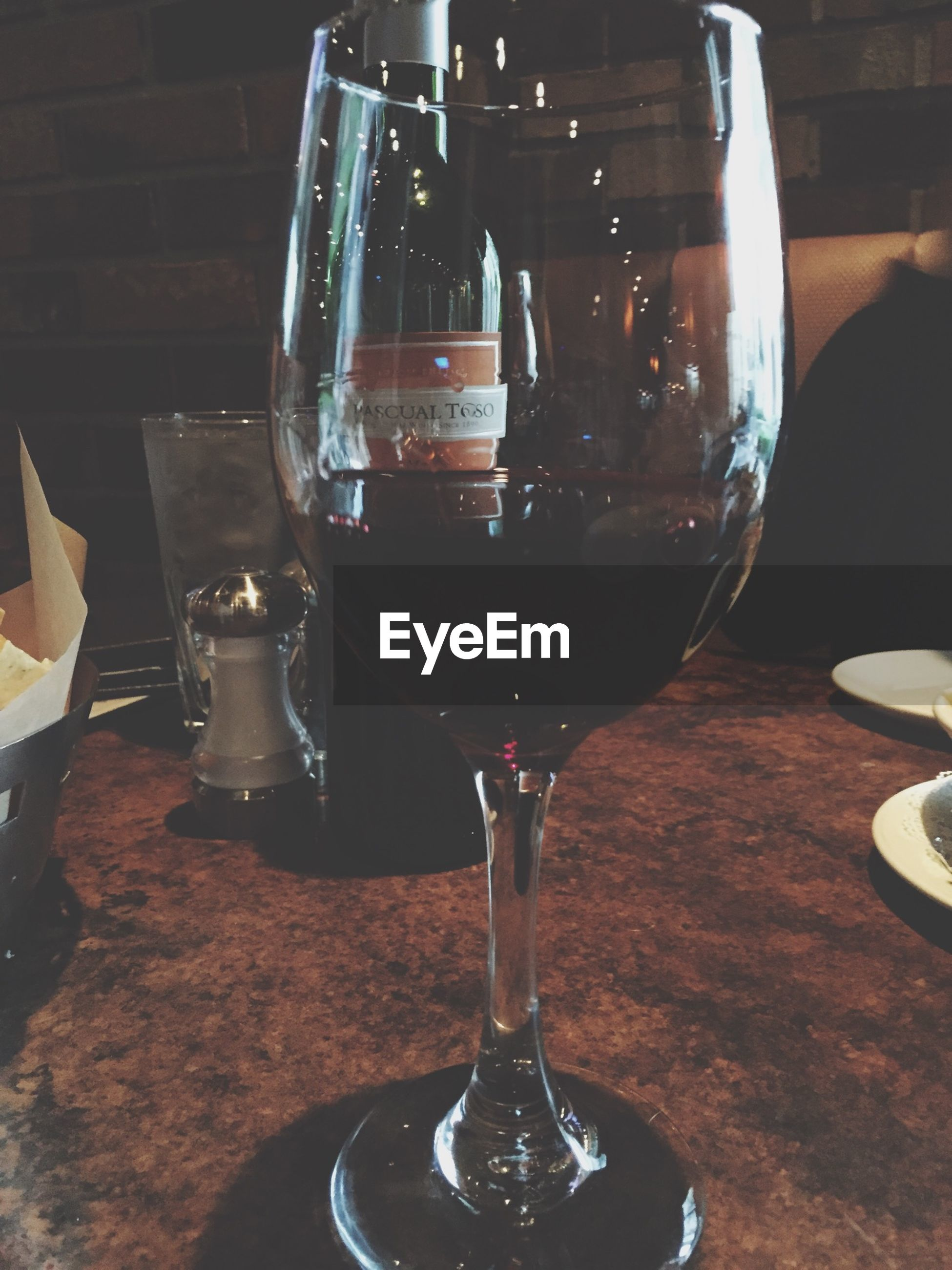 food and drink, drink, drinking glass, refreshment, table, indoors, alcohol, wineglass, freshness, still life, wine, glass - material, close-up, restaurant, glass, transparent, red wine, focus on foreground, serving size, wine glass