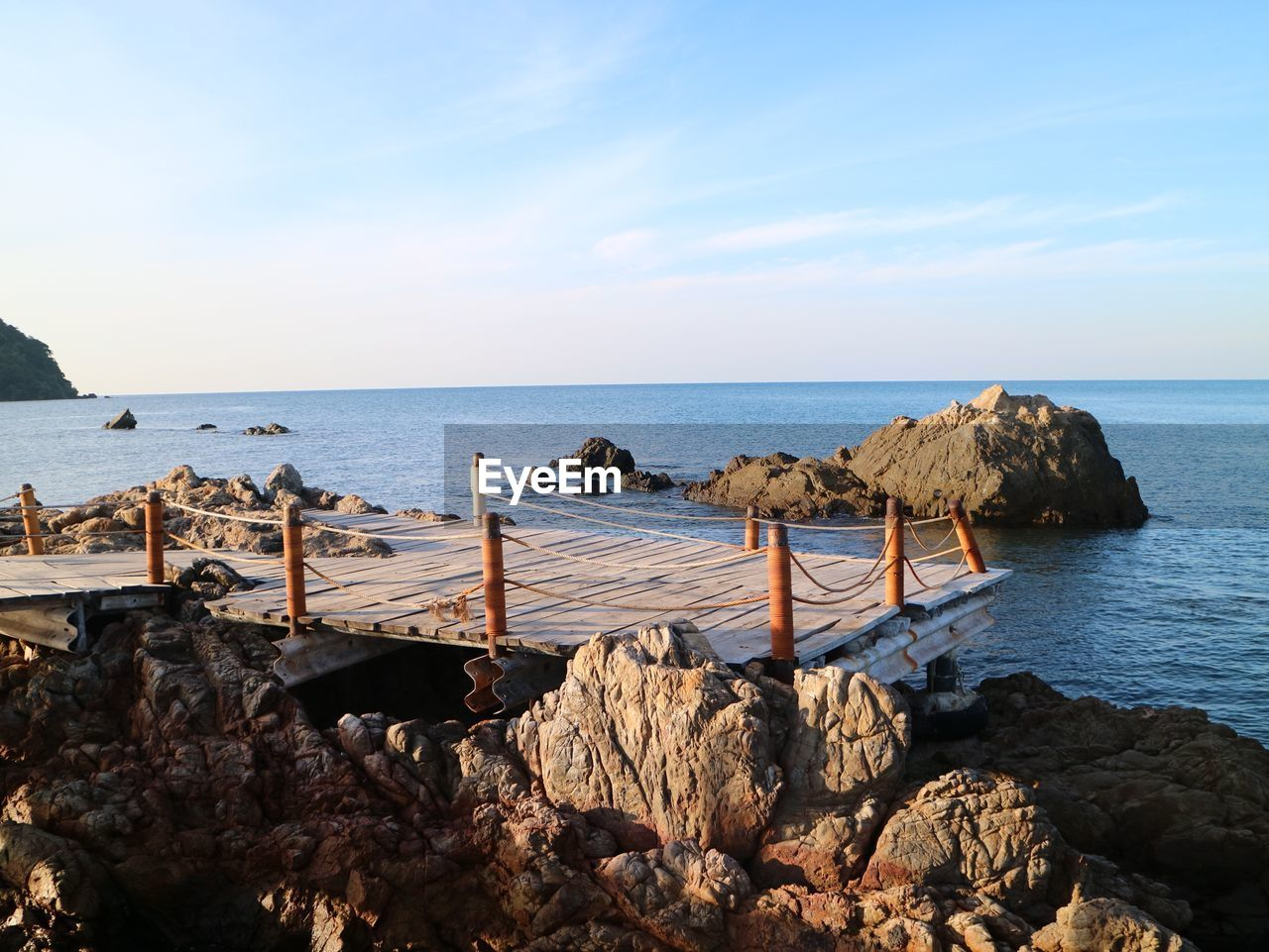 water, sea, sky, rock, horizon, horizon over water, scenics - nature, solid, rock - object, beauty in nature, tranquil scene, nature, tranquility, land, beach, no people, wood - material, day, non-urban scene