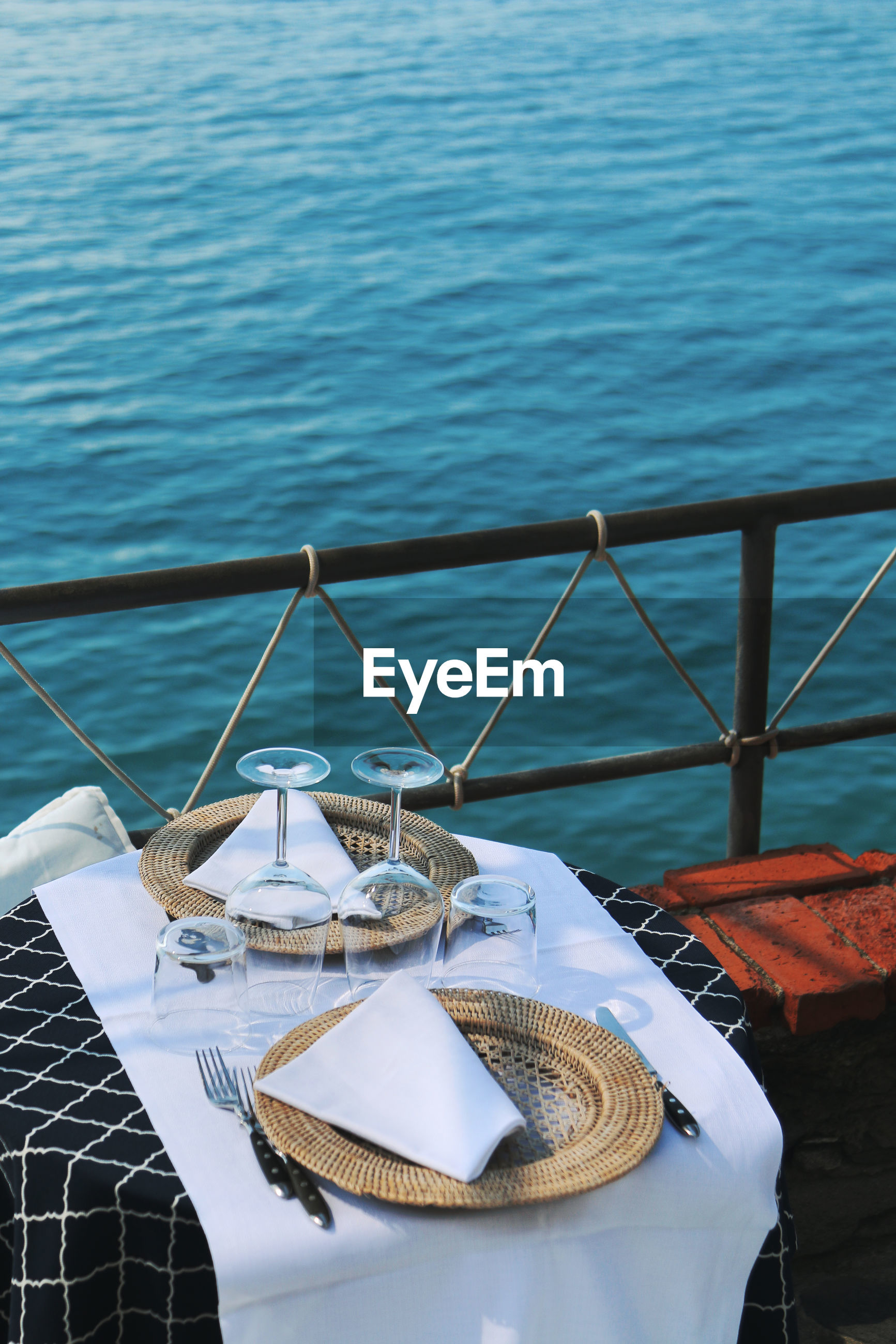High angle view of place setting on table by railing