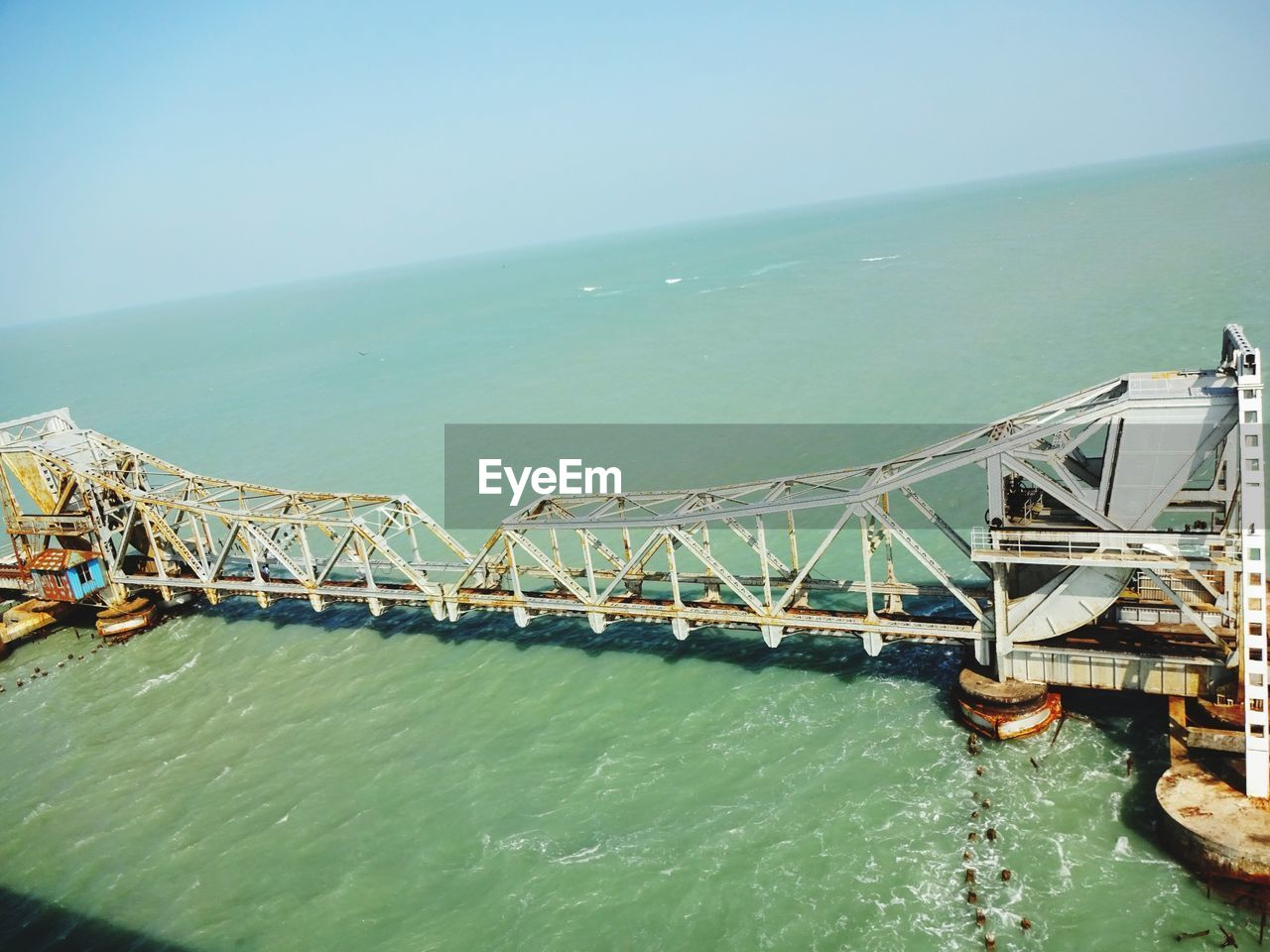 water, built structure, bridge - man made structure, architecture, sea, day, connection, transportation, outdoors, no people, nature, travel destinations, sky, scenics, clear sky, beauty in nature