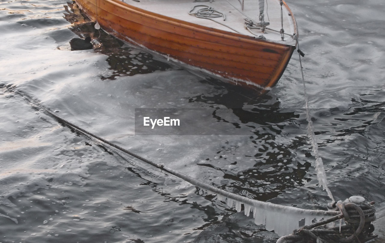 High angle view of boat moored at port during winter