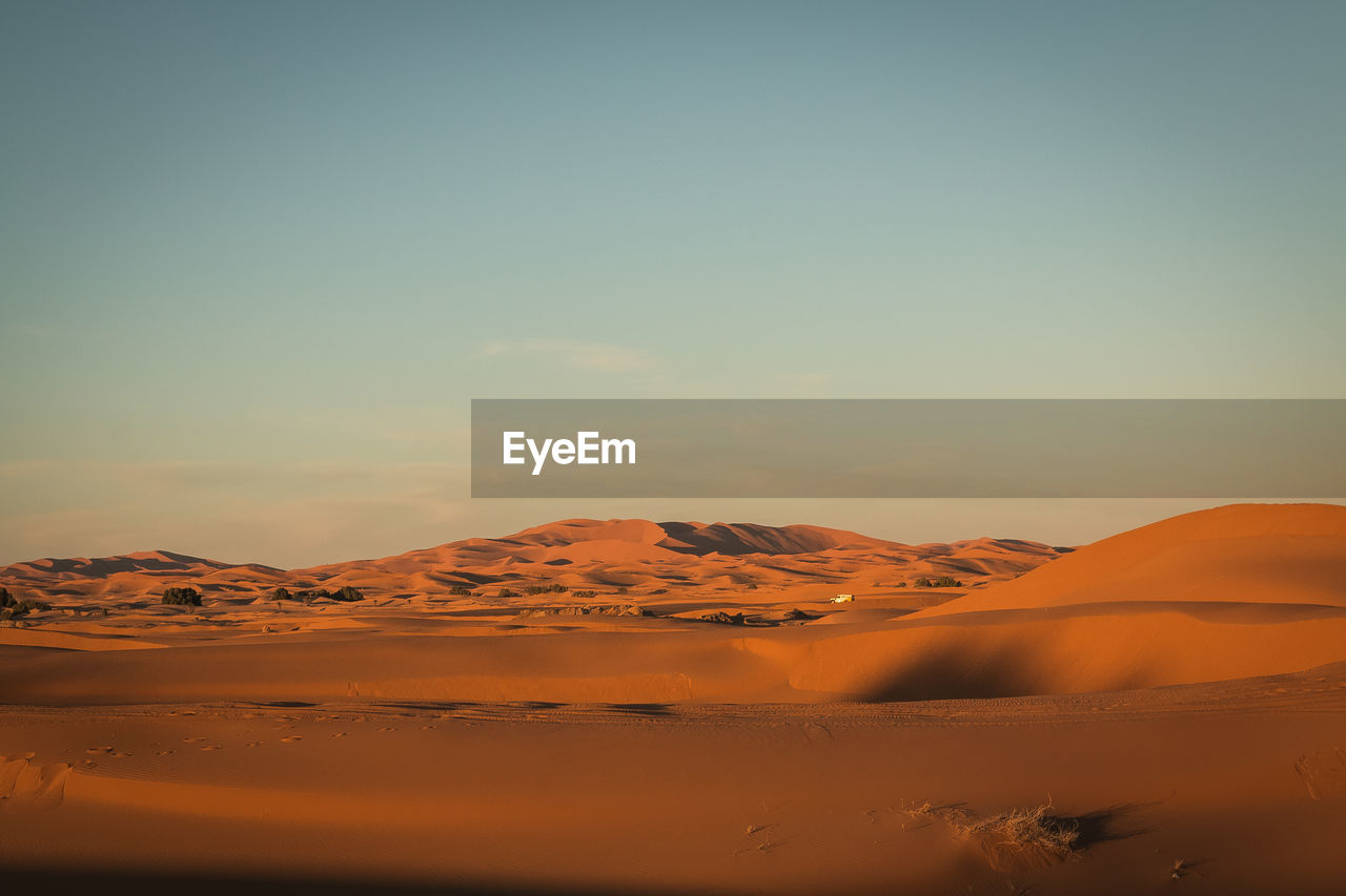 desert, scenics - nature, landscape, sky, beauty in nature, environment, tranquil scene, tranquility, sand, arid climate, sand dune, non-urban scene, climate, land, remote, no people, nature, idyllic, physical geography, sunset, outdoors, atmospheric