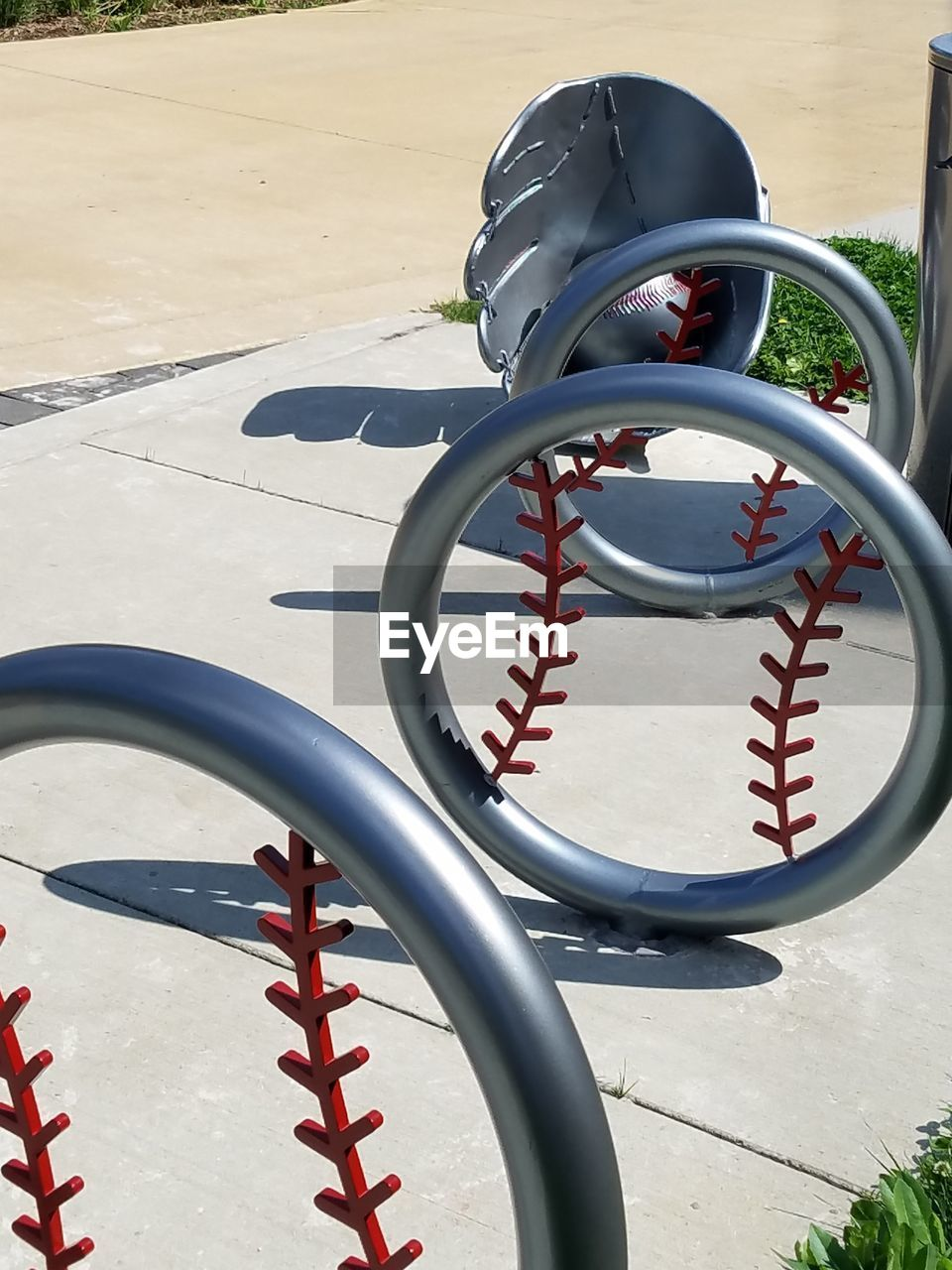 sunlight, day, high angle view, outdoors, no people, bicycle rack, shadow, spiral, bicycle, nature, close-up