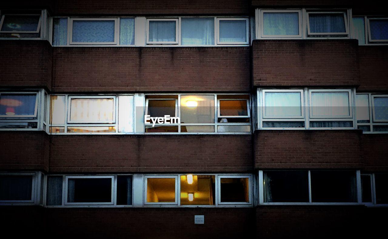 Full Frame Shot Of Apartment Windows