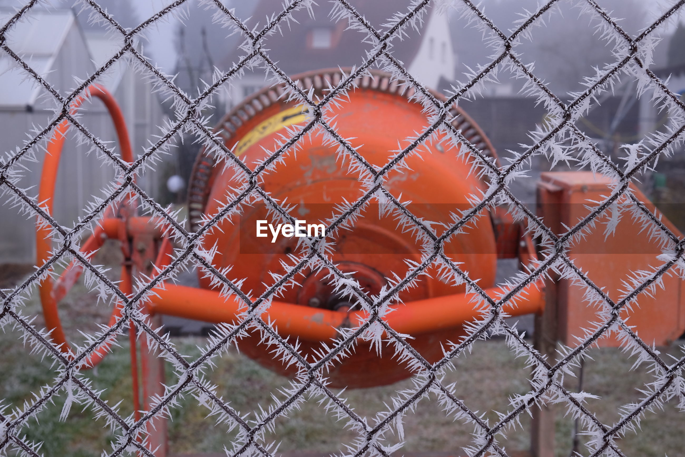 Full frame shot of machinery behind chainlink fence