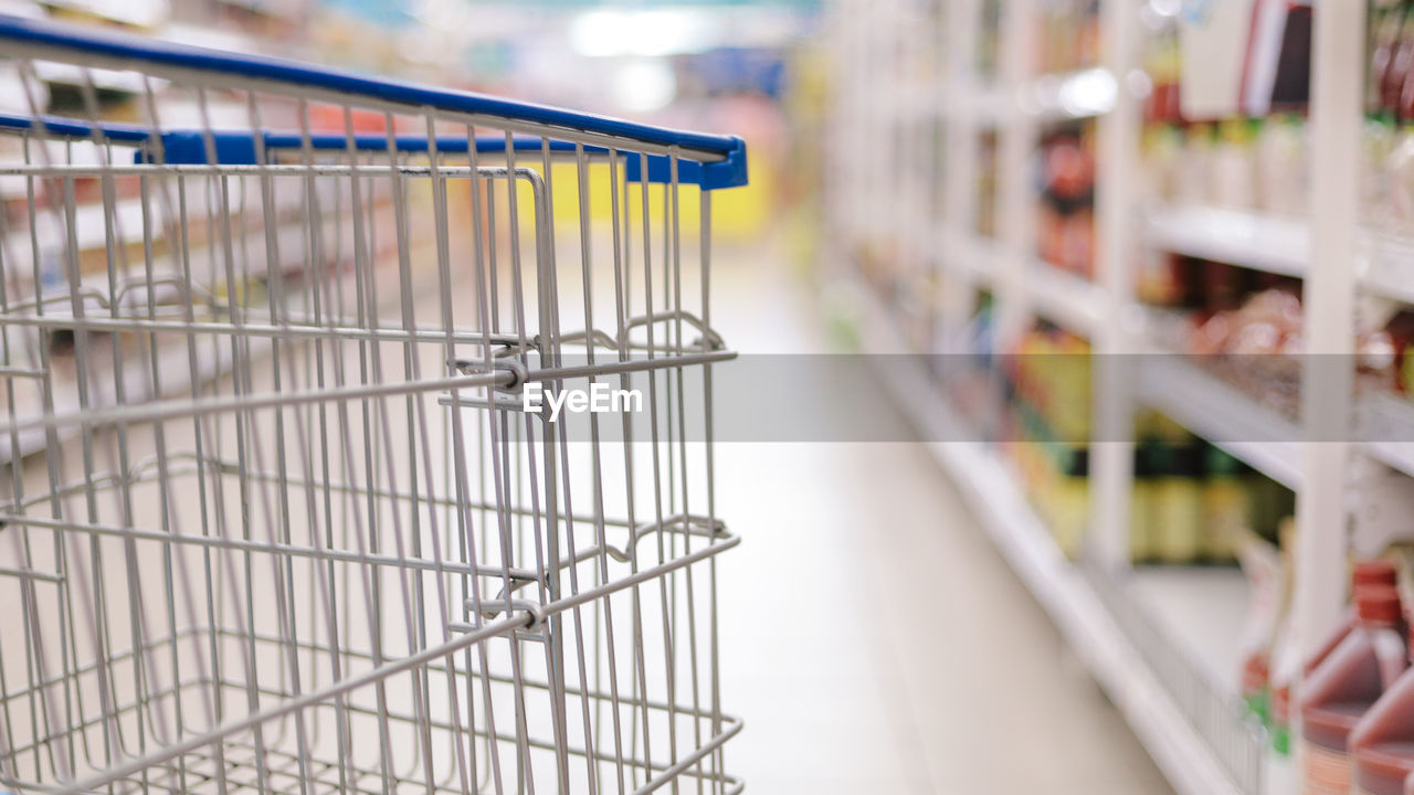 shopping, retail, store, shopping cart, supermarket, consumerism, focus on foreground, choice, indoors, shelf, groceries, food, market, food and drink, variation, large group of objects, close-up, empty, no people, abundance, aisle