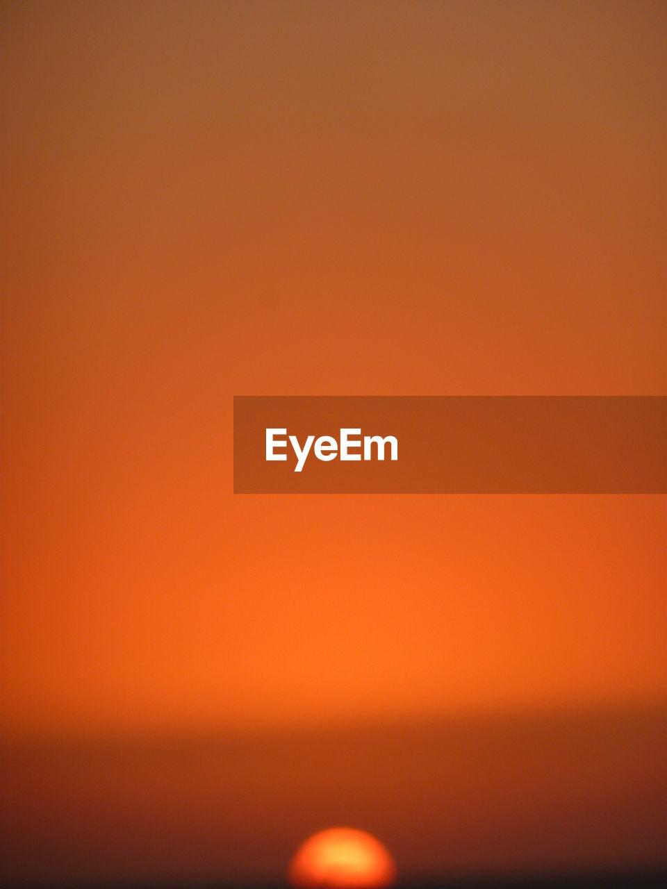 FULL FRAME SHOT OF ILLUMINATED ORANGE SUNSET SKY