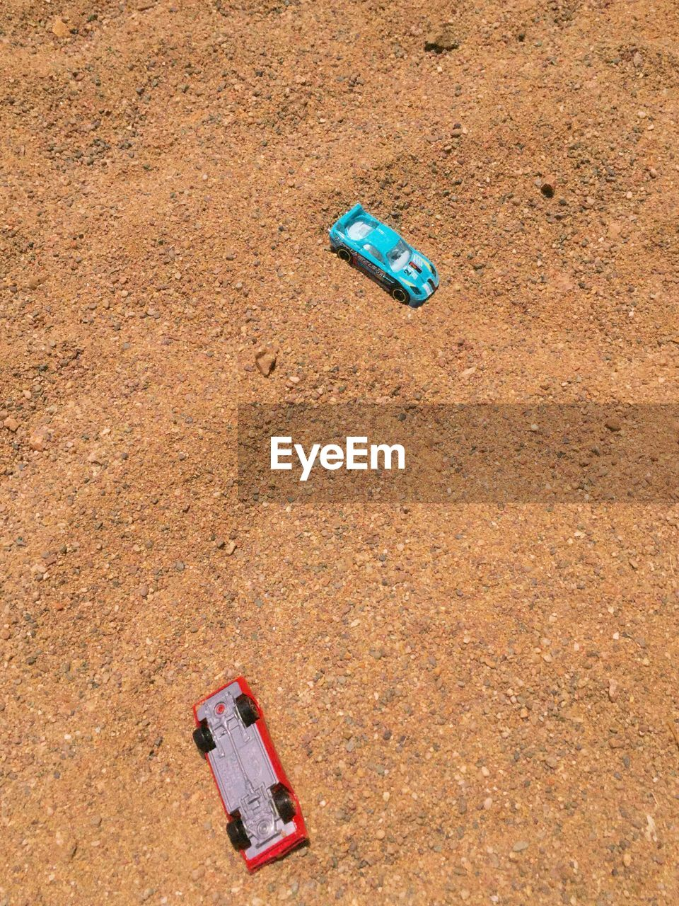 land, high angle view, container, blue, bottle, nature, sand, day, environment, no people, single object, water, beach, plastic, red, garbage, outdoors, summer, dirt, abandoned, pollution