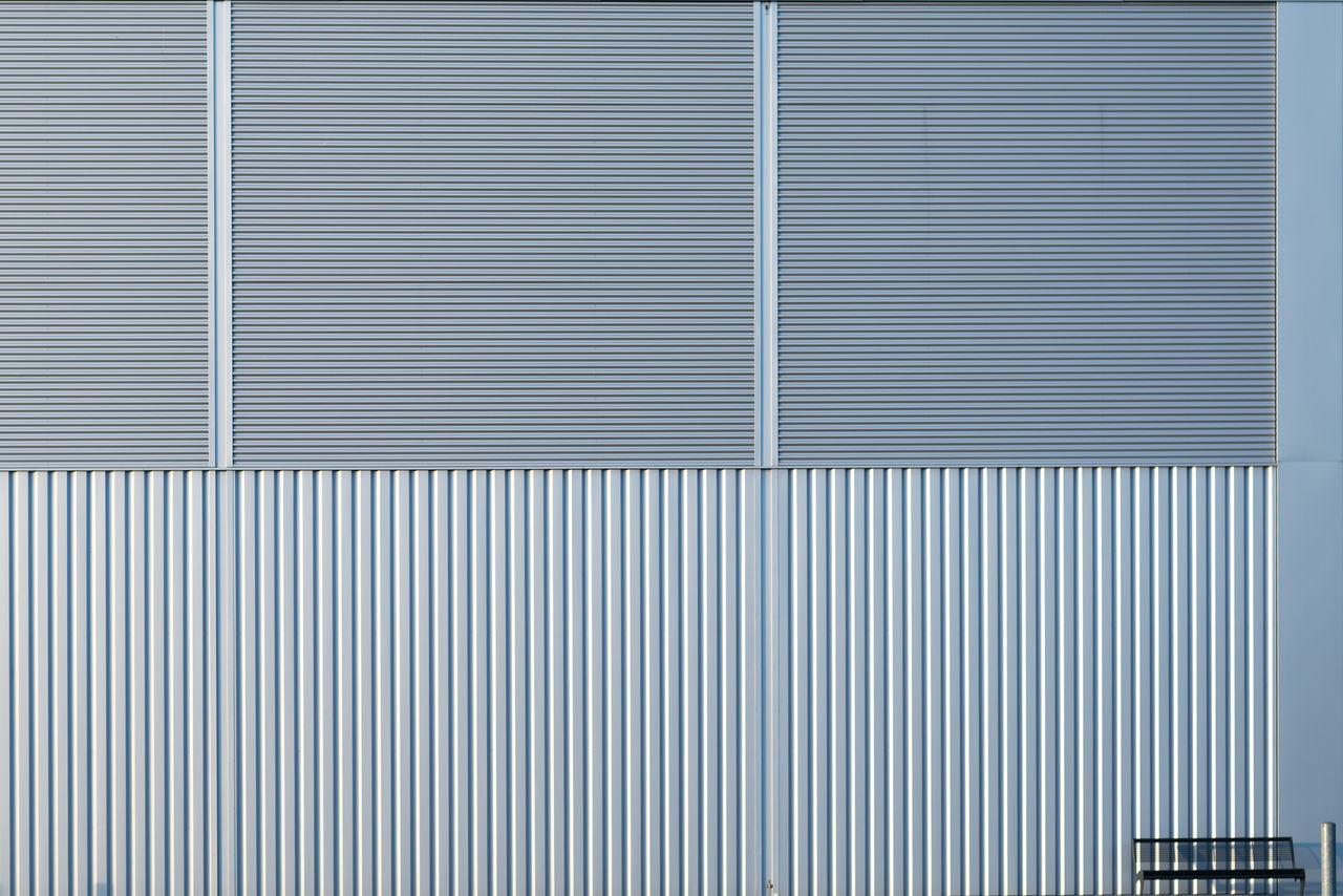 Metallic wall of building in city
