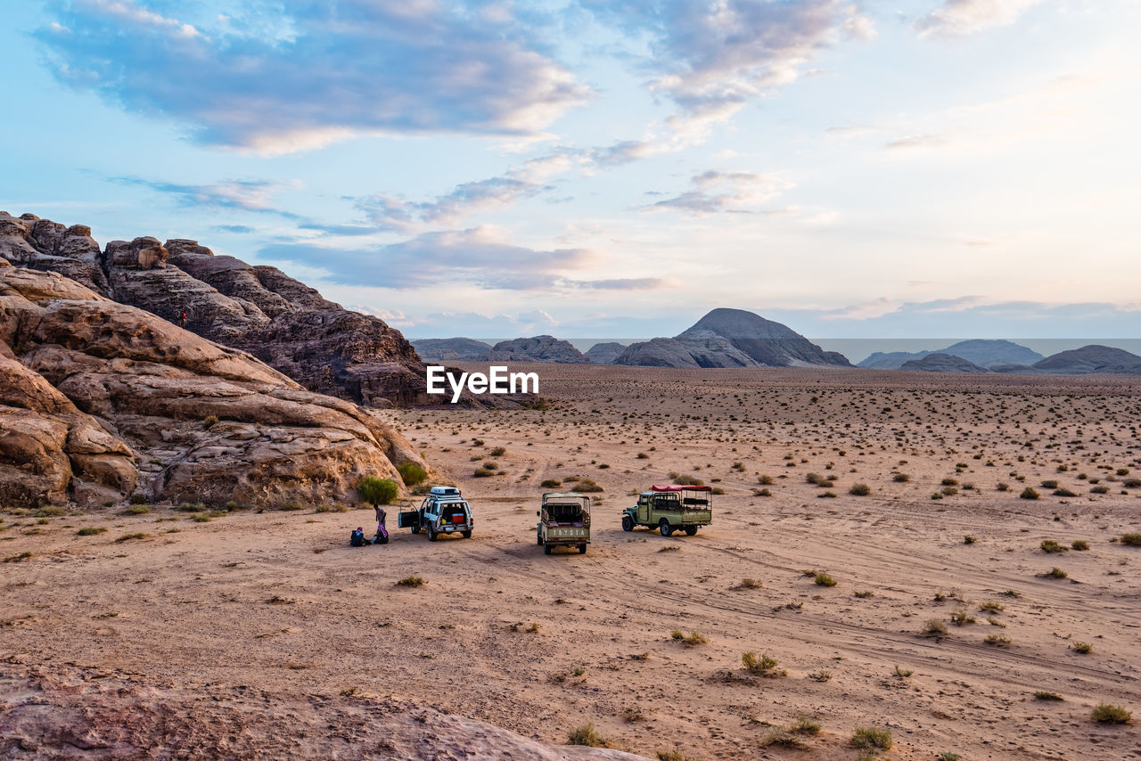 Off-Road Vehicles At Desert Against Sky