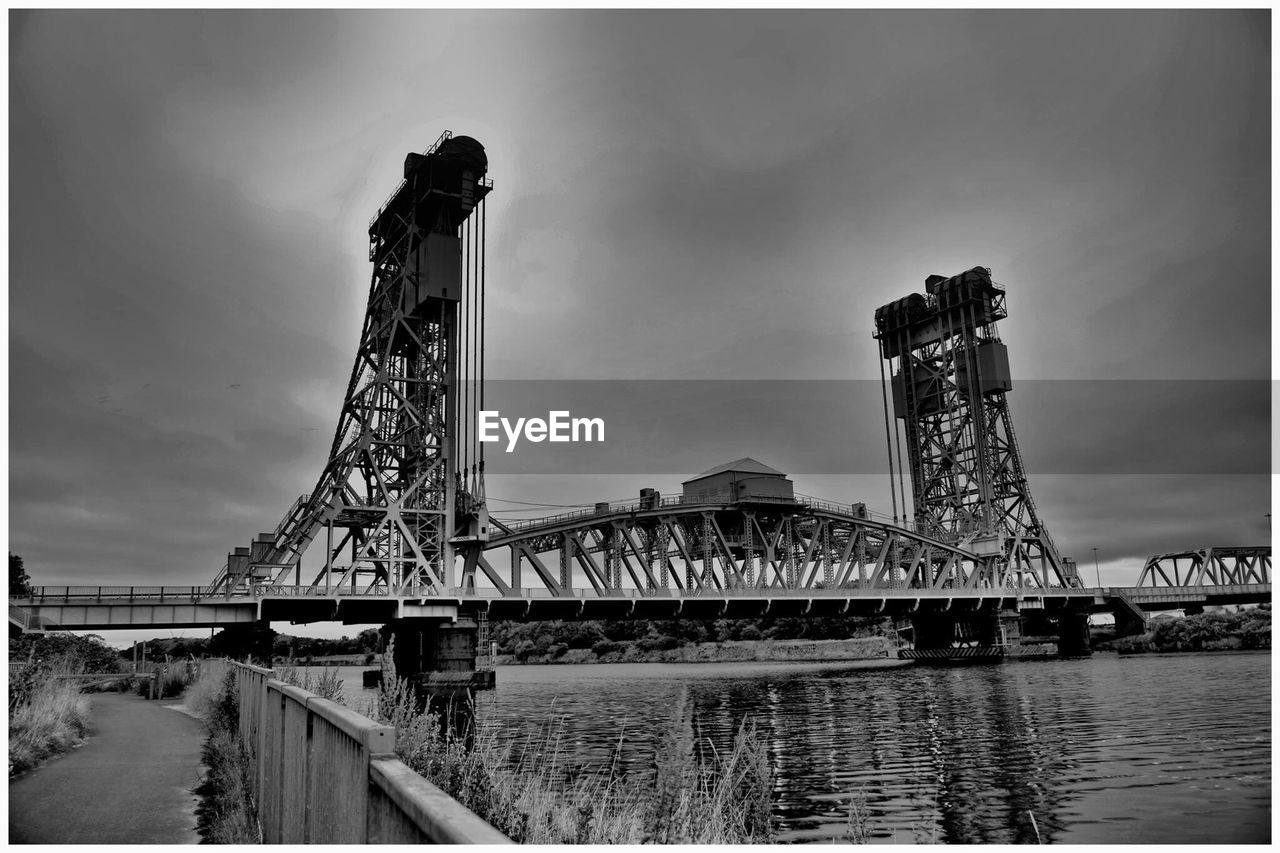 architecture, built structure, water, sky, connection, bridge, bridge - man made structure, nature, auto post production filter, river, transportation, cloud - sky, travel destinations, engineering, transfer print, tower, waterfront, metal, outdoors, bay