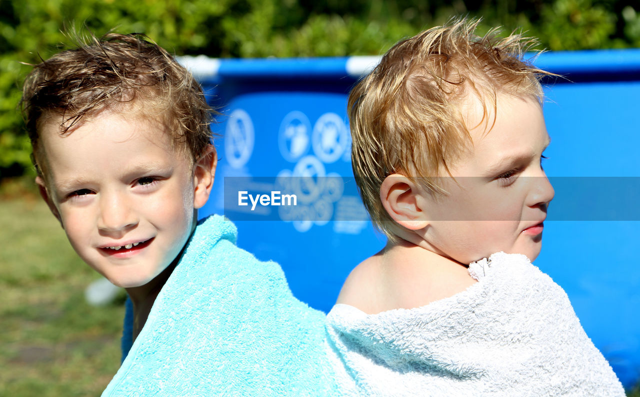 Portrait Of Of Boys By Swimming Pool